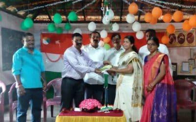 Handing over of cheque towards a teacher's salary to DK ZP HP School Bengre