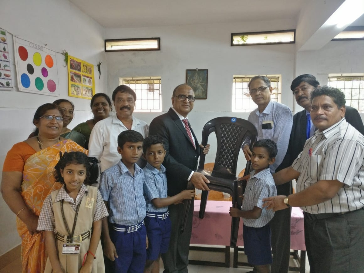 Donation of Chairs to School